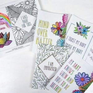 Set of ready-to-color birth affirmation cards on a white table